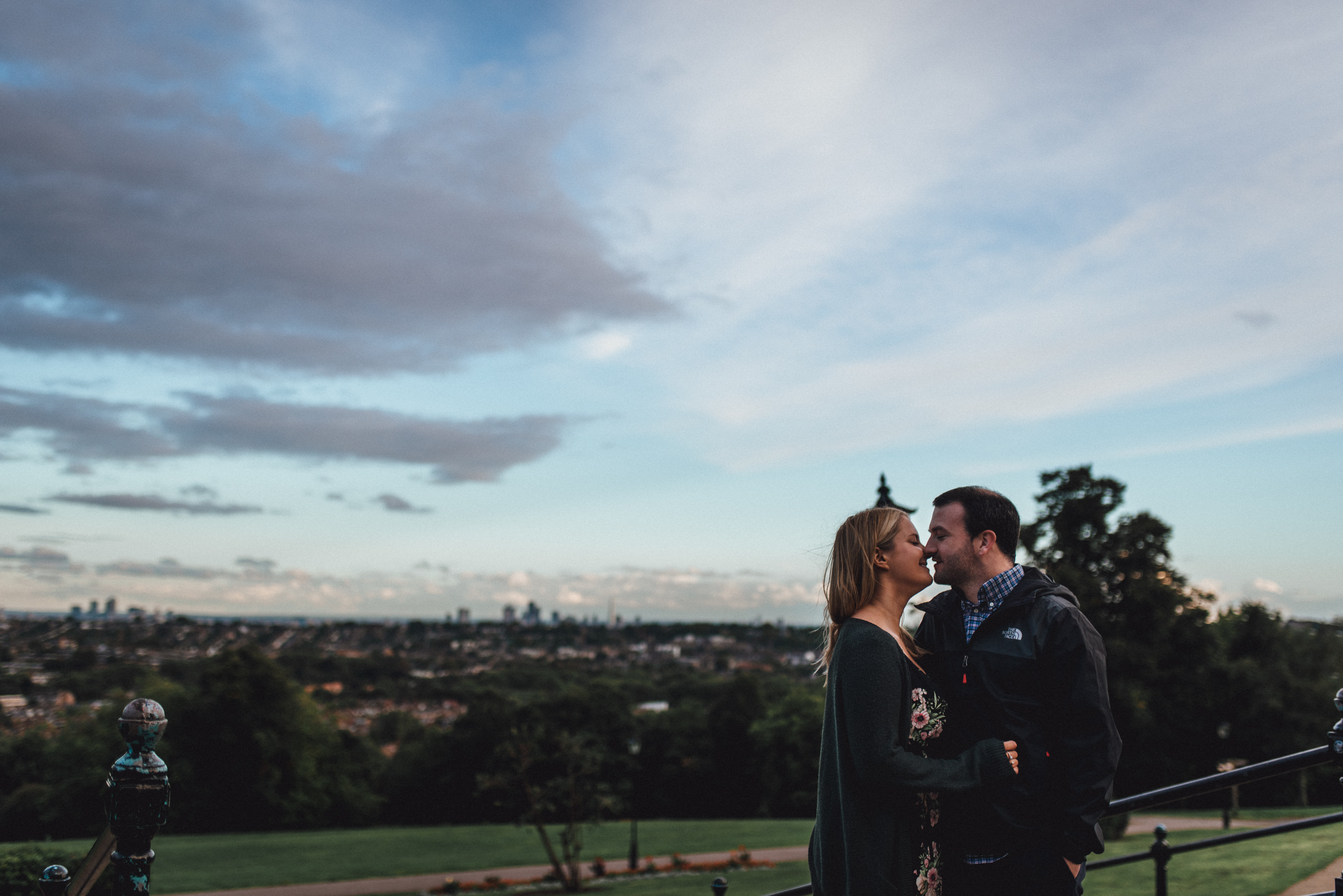 Couple kiss at the top of Alexandra Palace. Romantic engagement photography idea