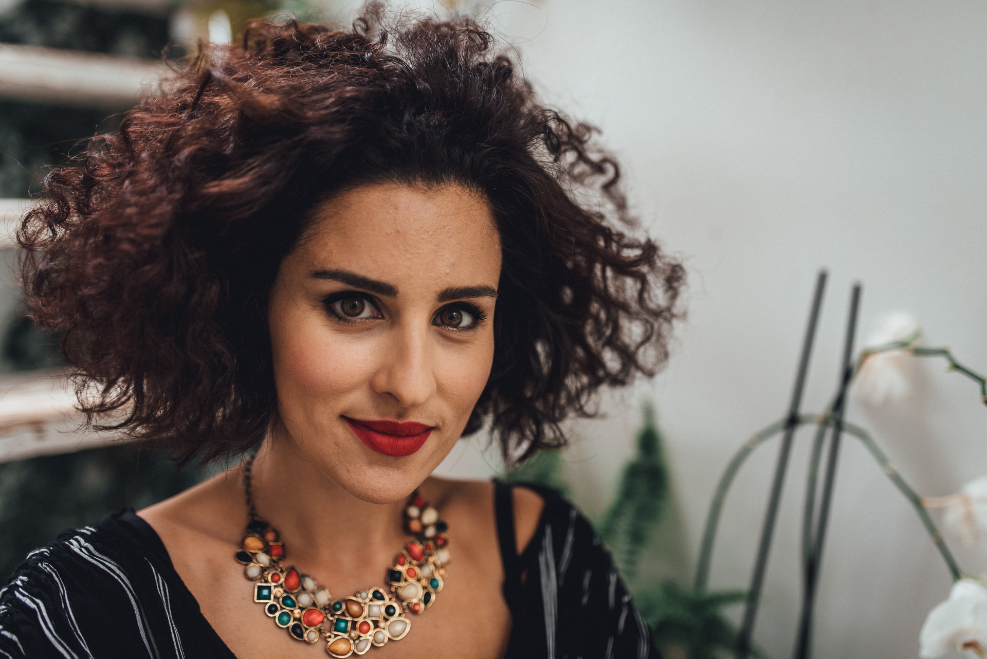 Headshot of curly haired woman - Creative portrait photography, London