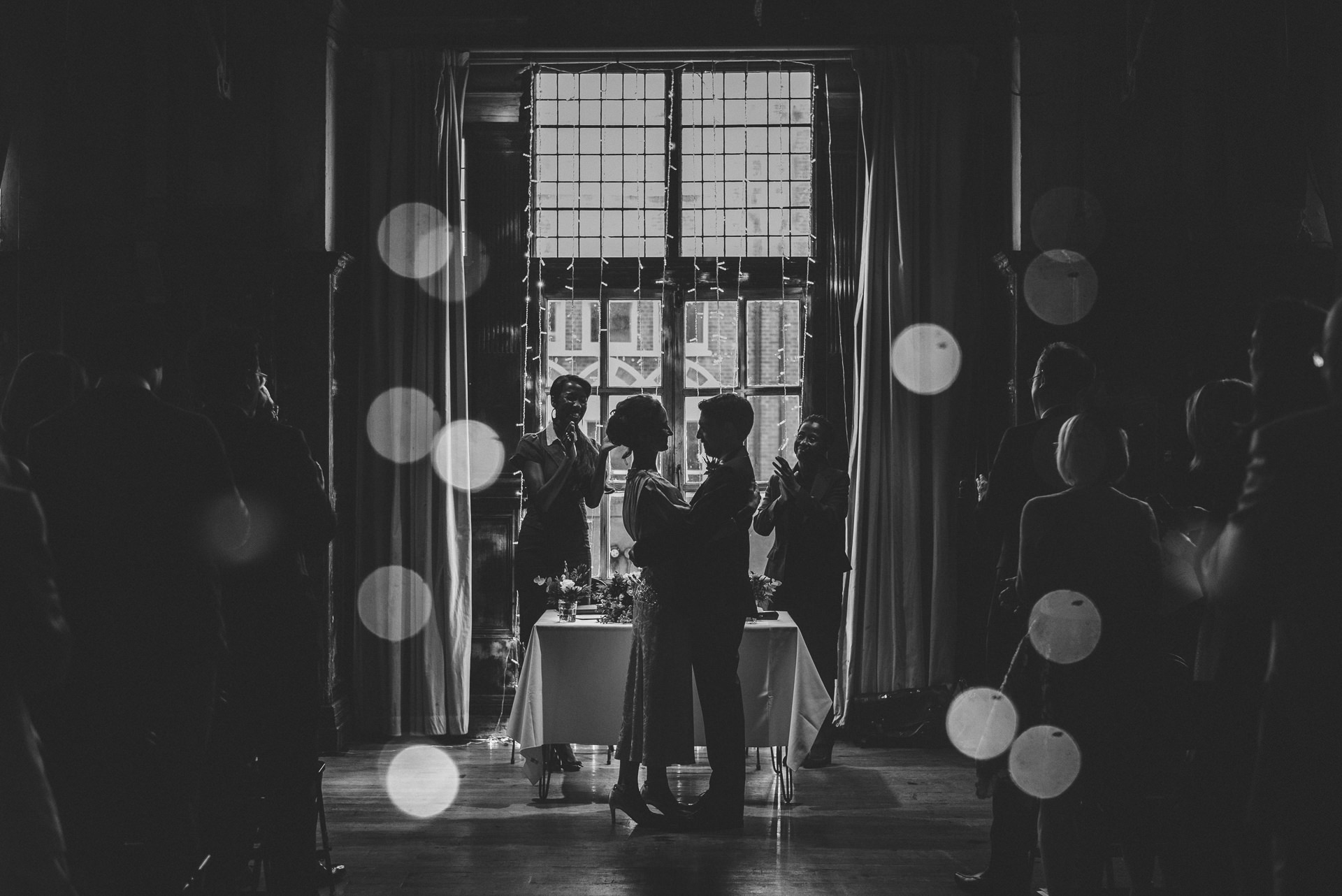 Couple embrace after their first kiss. Creative London wedding photography ideas