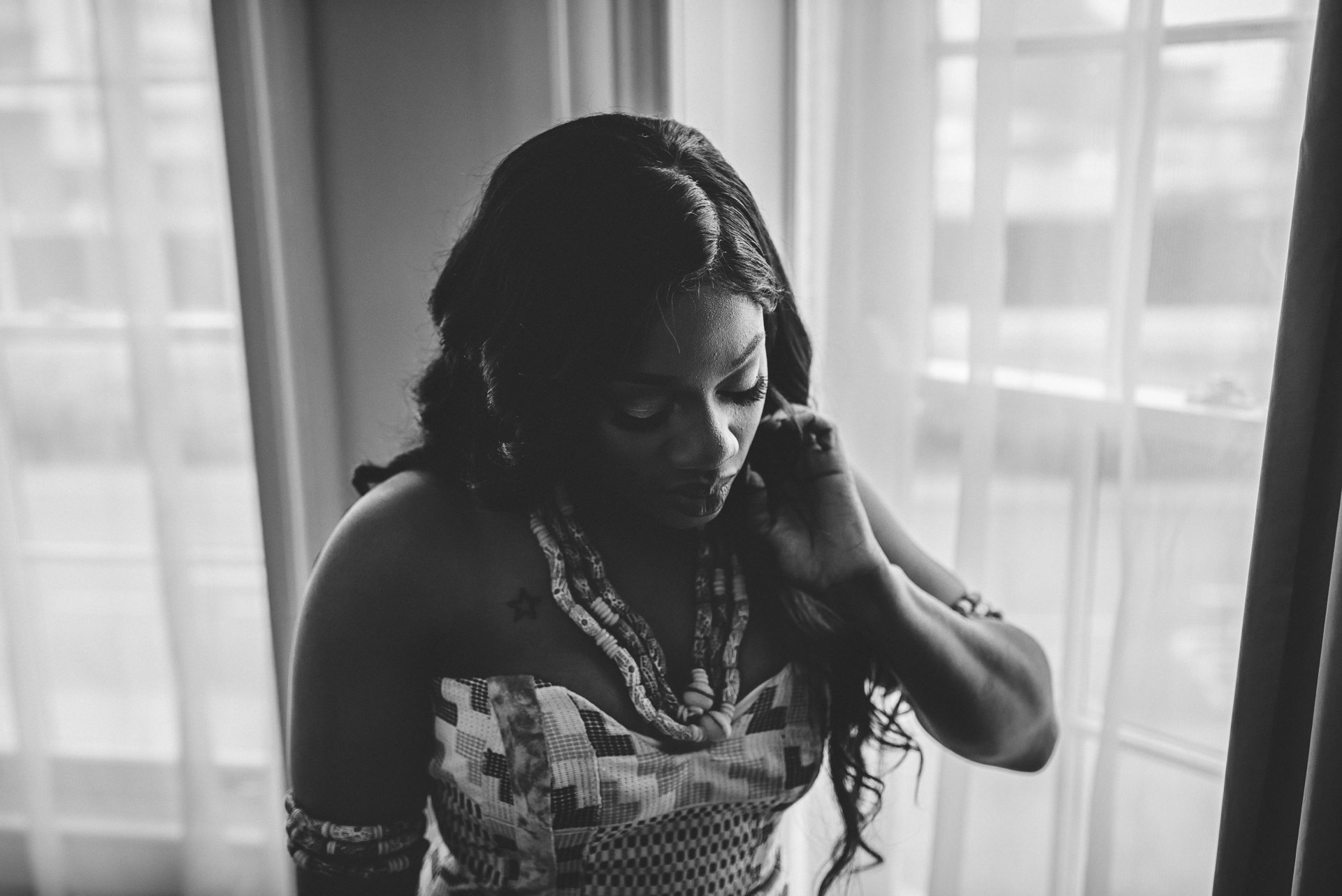 Portrait of bride in front of a window. Creative London Wedding Photography