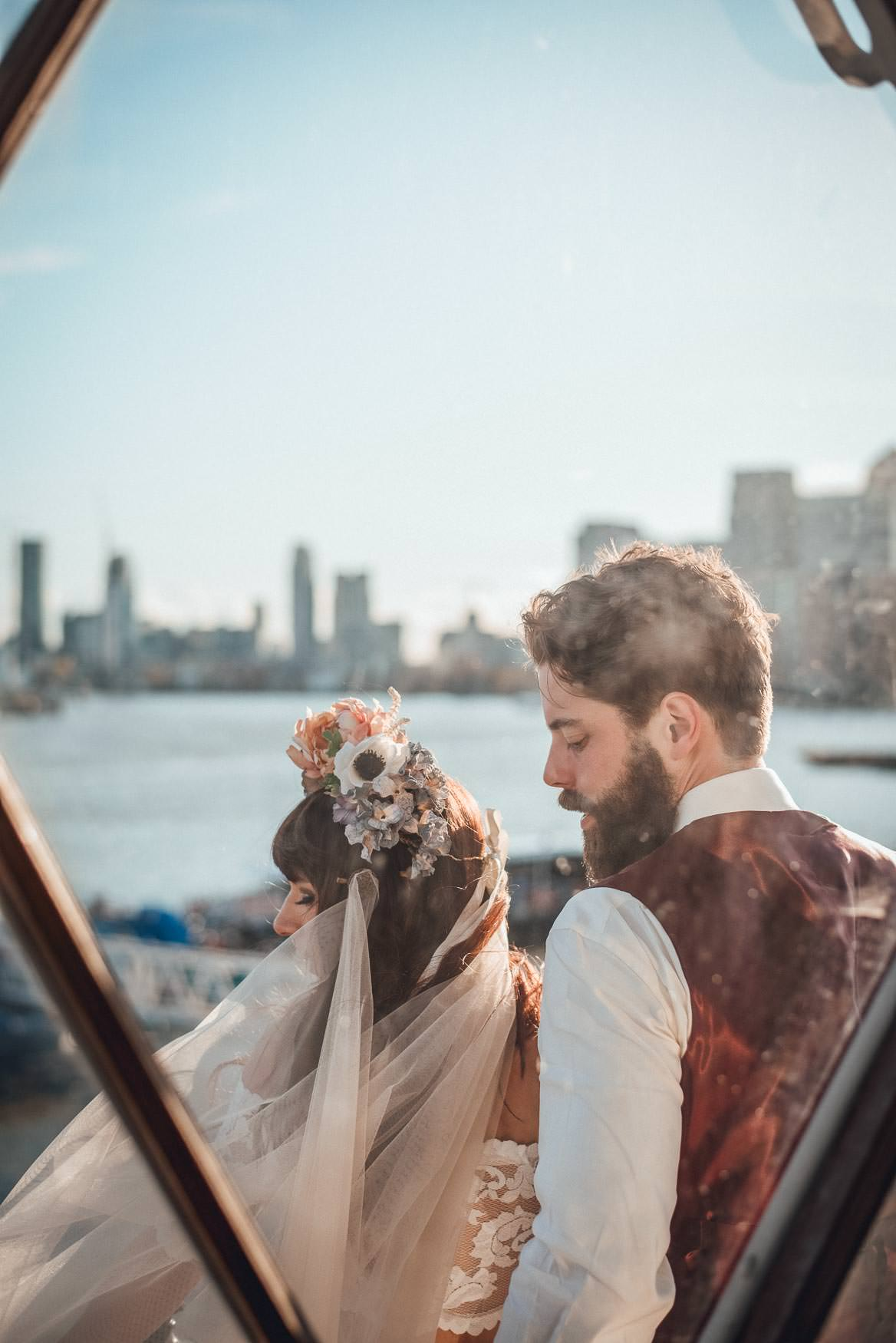 Couple , framed by a window overlooking a london cityscape. Alternative, Creative Wedding photography Ideas