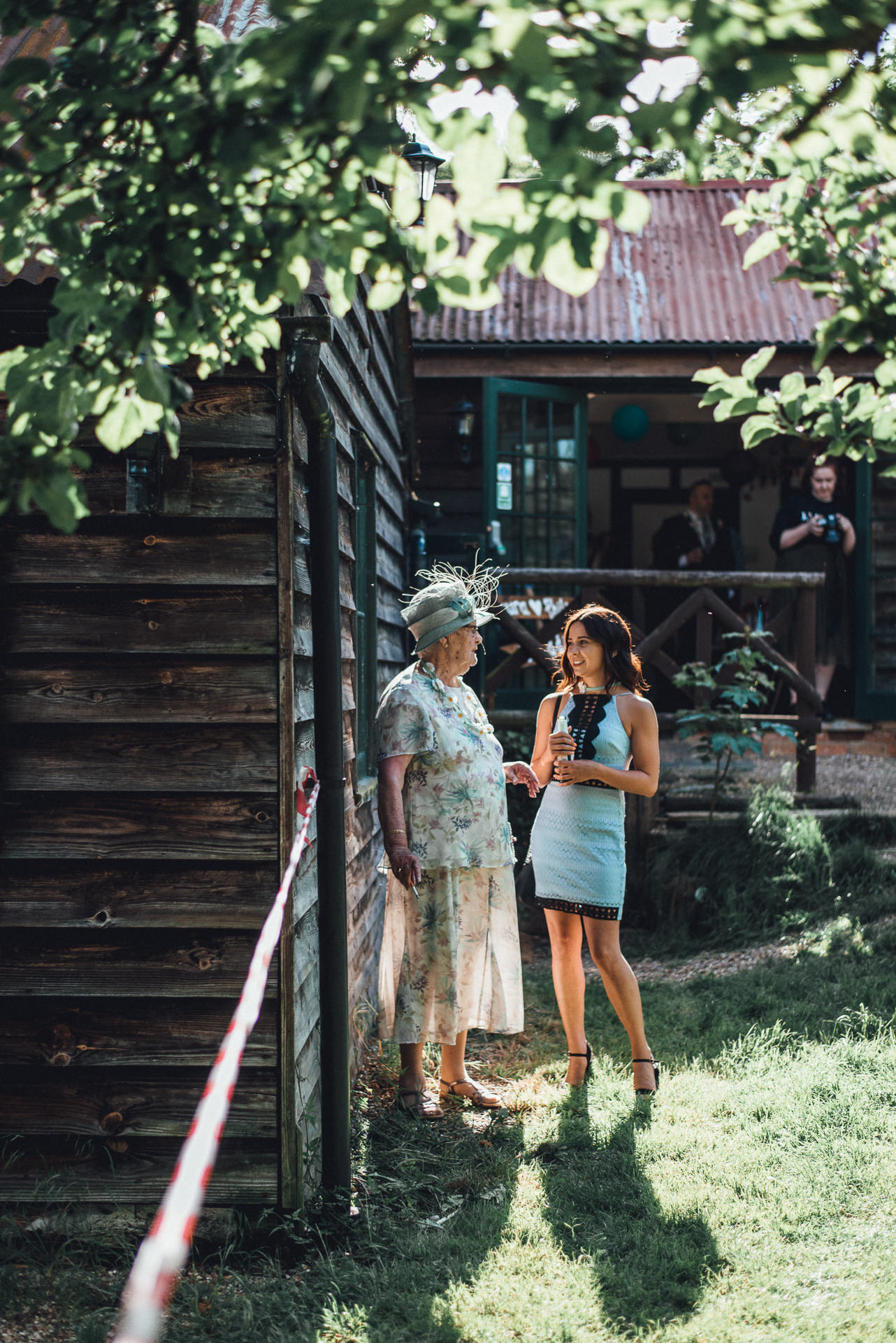 Two ladies standing outside in the sun. Creative wedding photography ideas