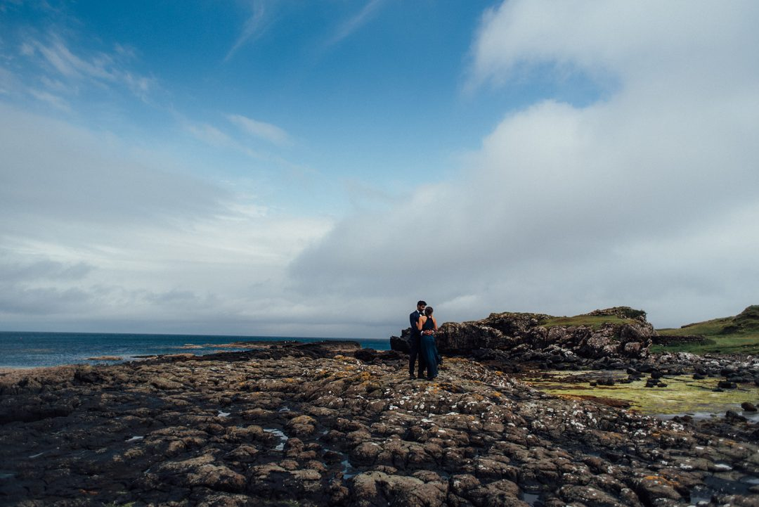 couple stand in the middle of a dramatic landscape at Brothers Point