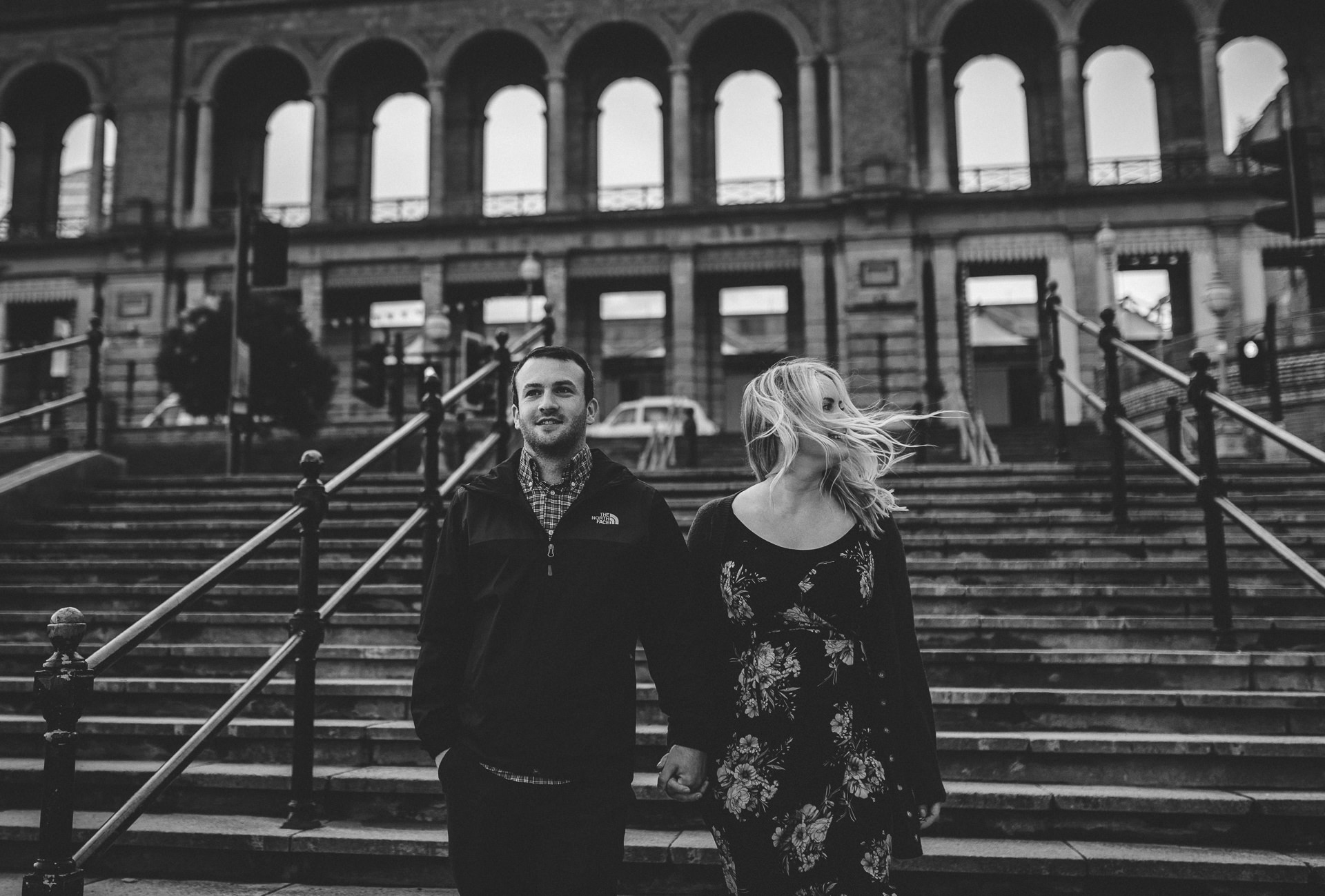 Couple walk down stairs at Ally Pally. Quirky London engagement photography