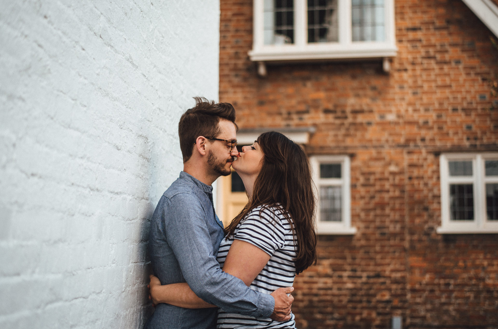 Woman kissing a her partner on the nose. Quirky london engagement shoot ideas