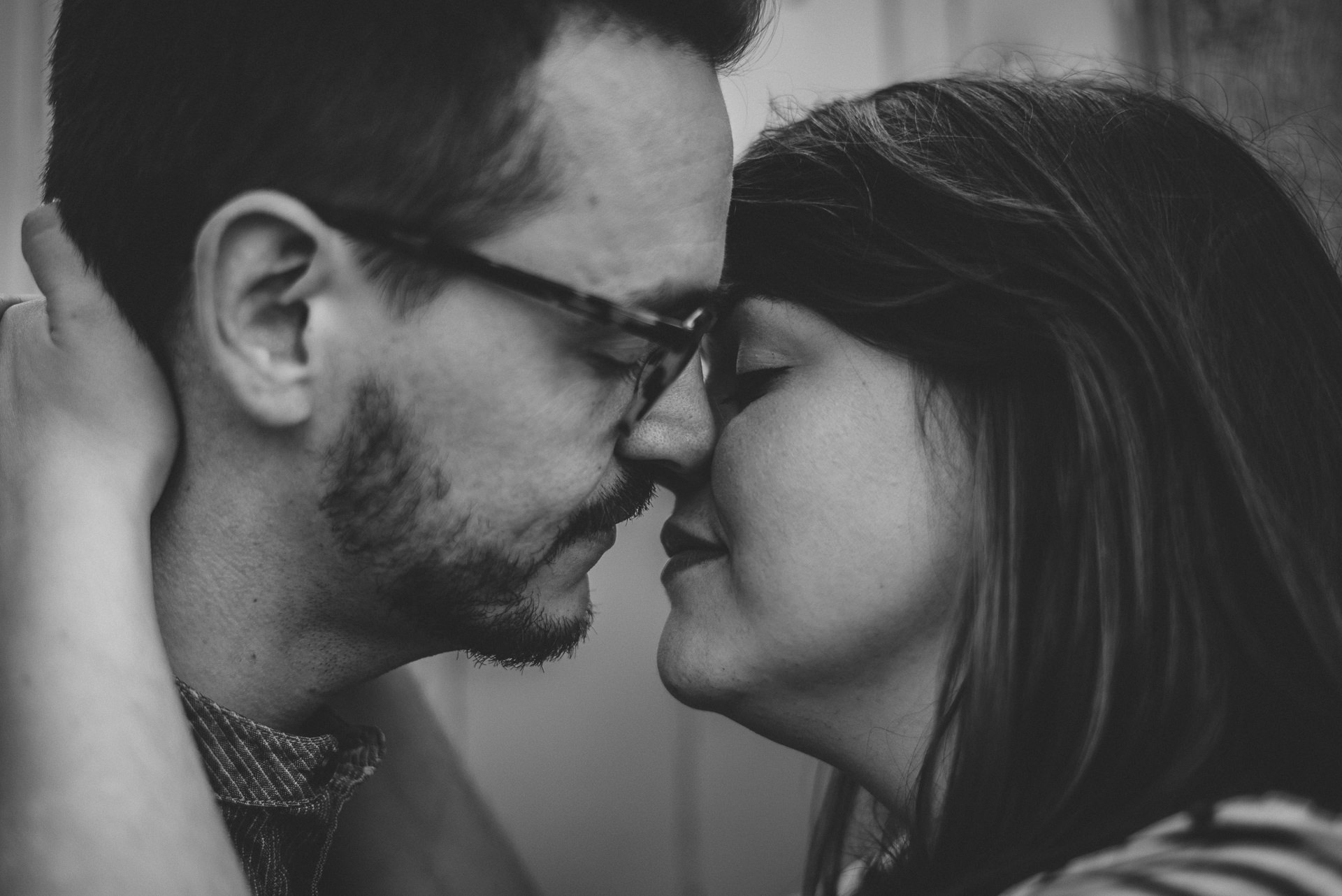 Couple, noses touching, about to kiss. Romantic, creative london engagement shoot ideas