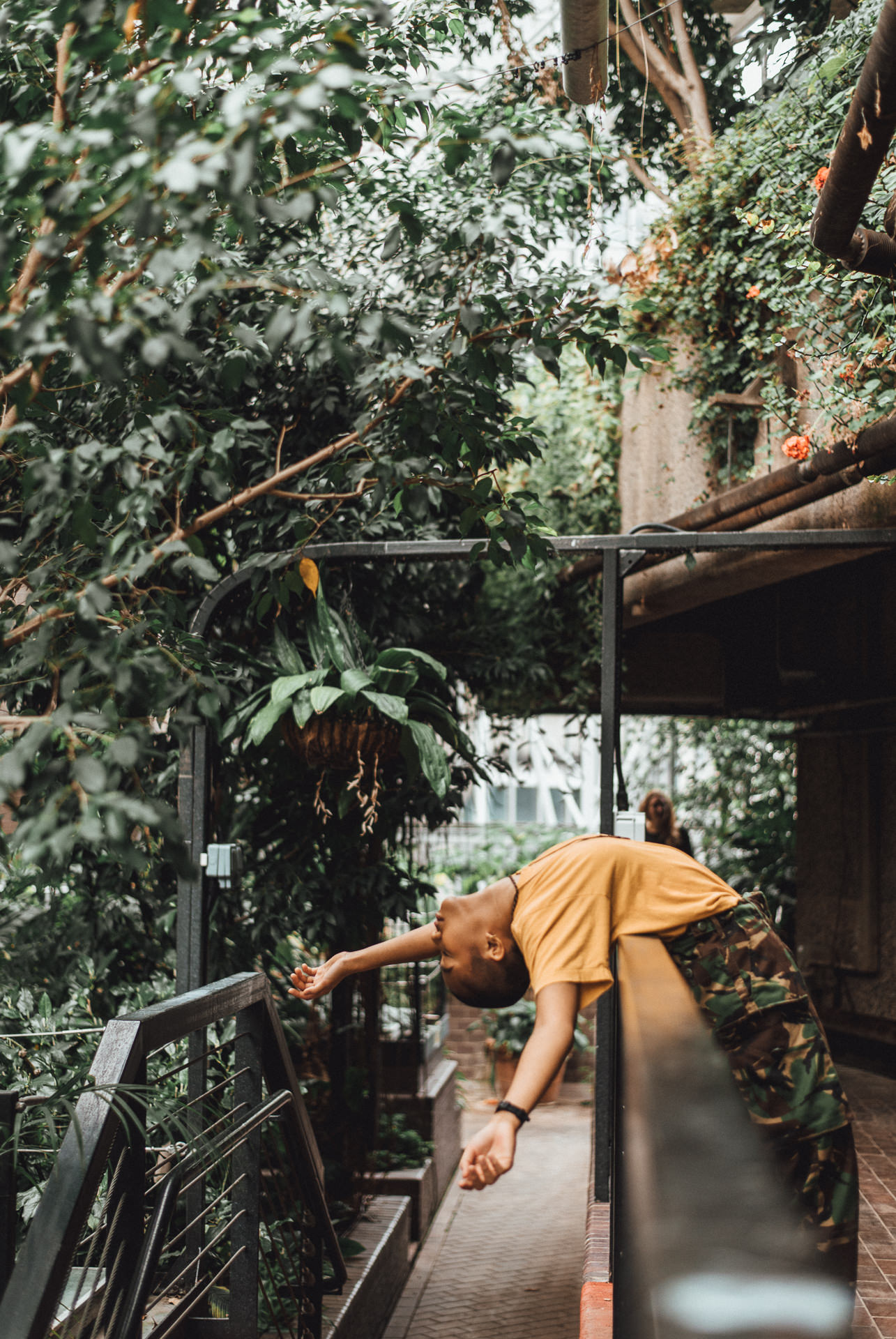 Dancer dramatically leaning over balcony - Creative london dance photography