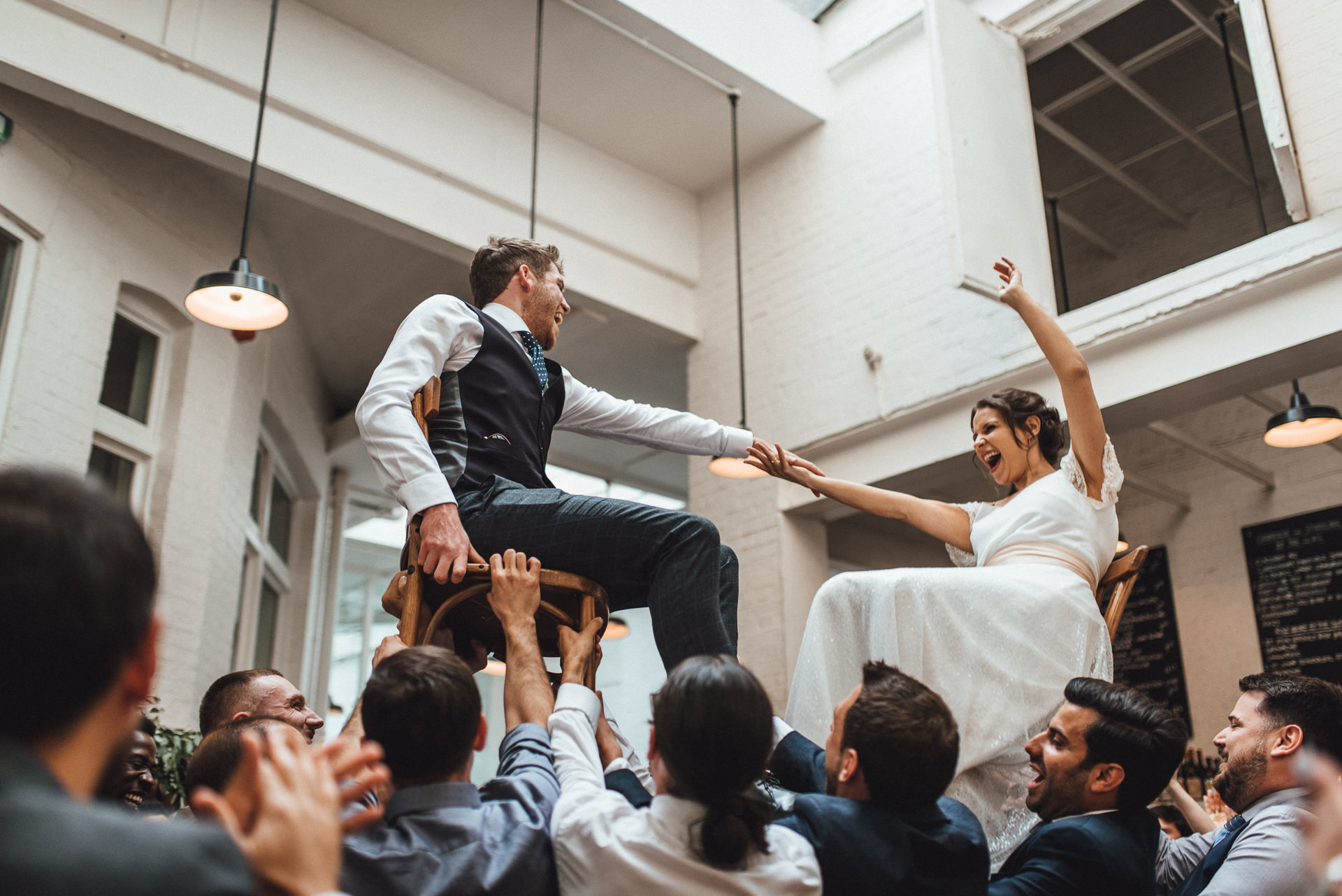 Bride and groom Israeli dancing. Fun alternative jewish wedding photography ideas