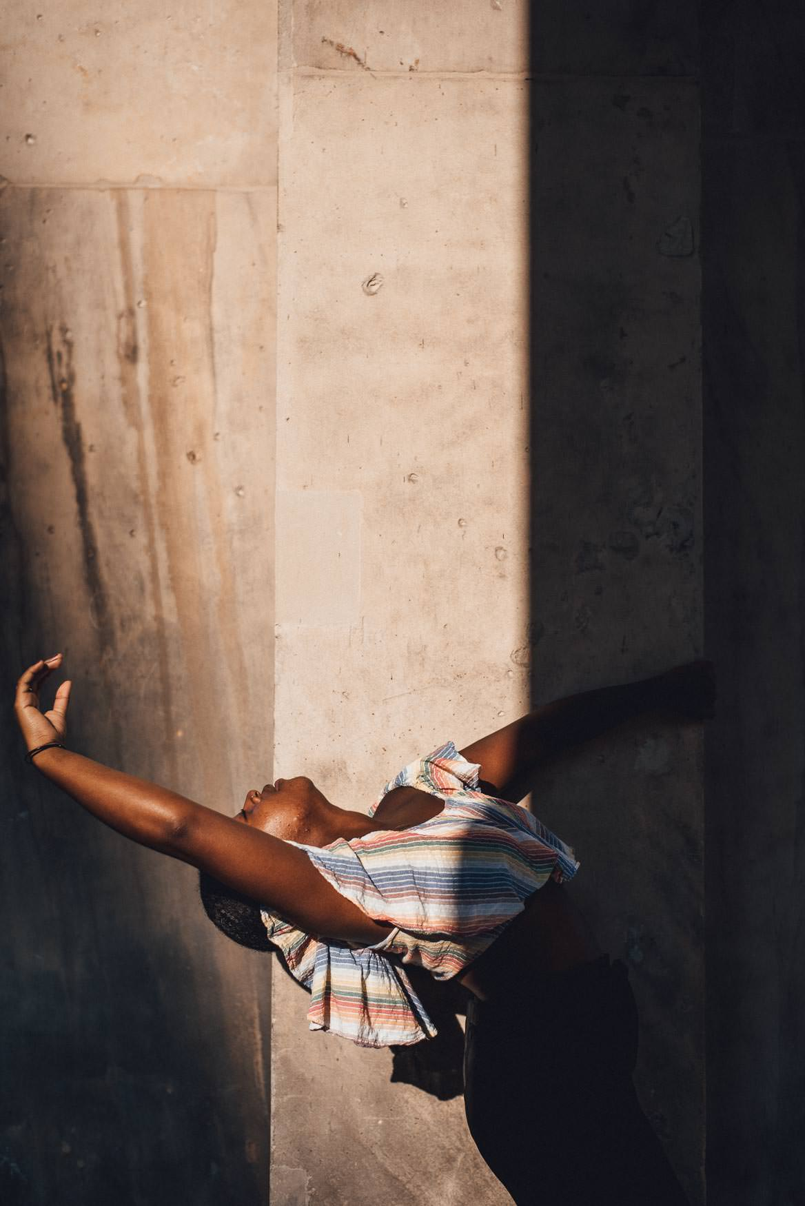 Dancer in light and shadow. Creative dance photography