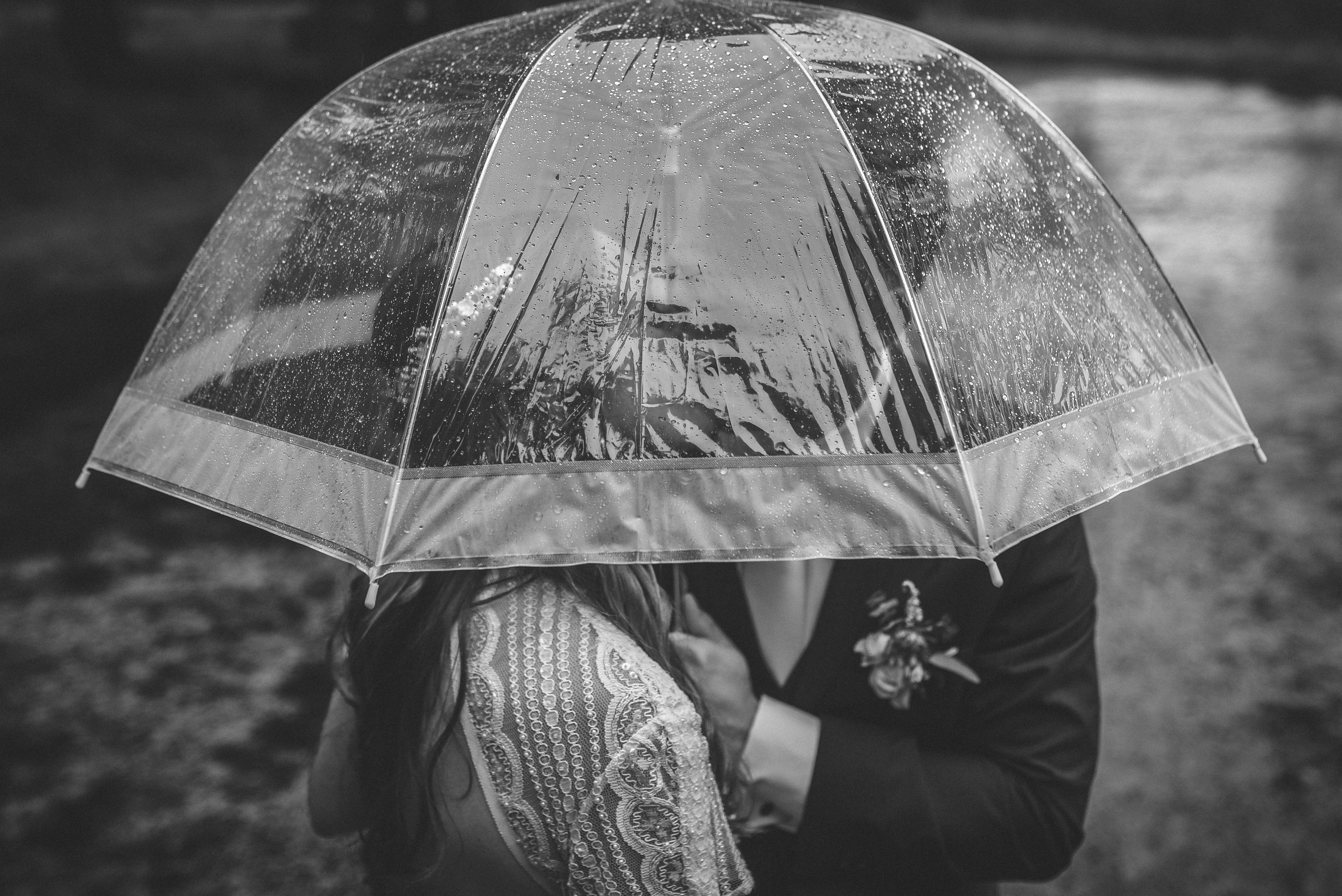 Couple kiss under an umbrella. Romantic rainy london wedding photography ideas.