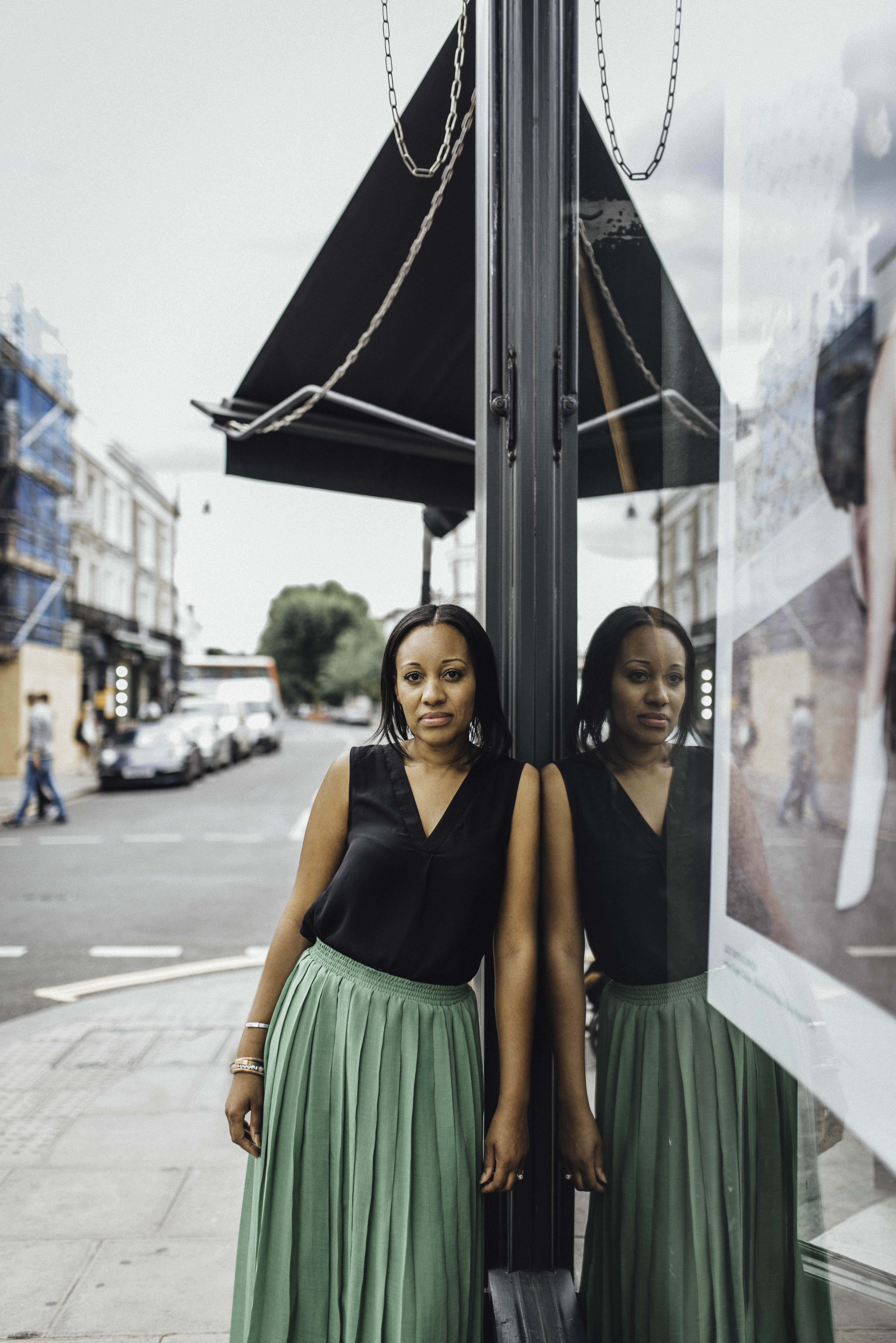 Creative portrait of a woman reflected against glass. Creative london branding shoot