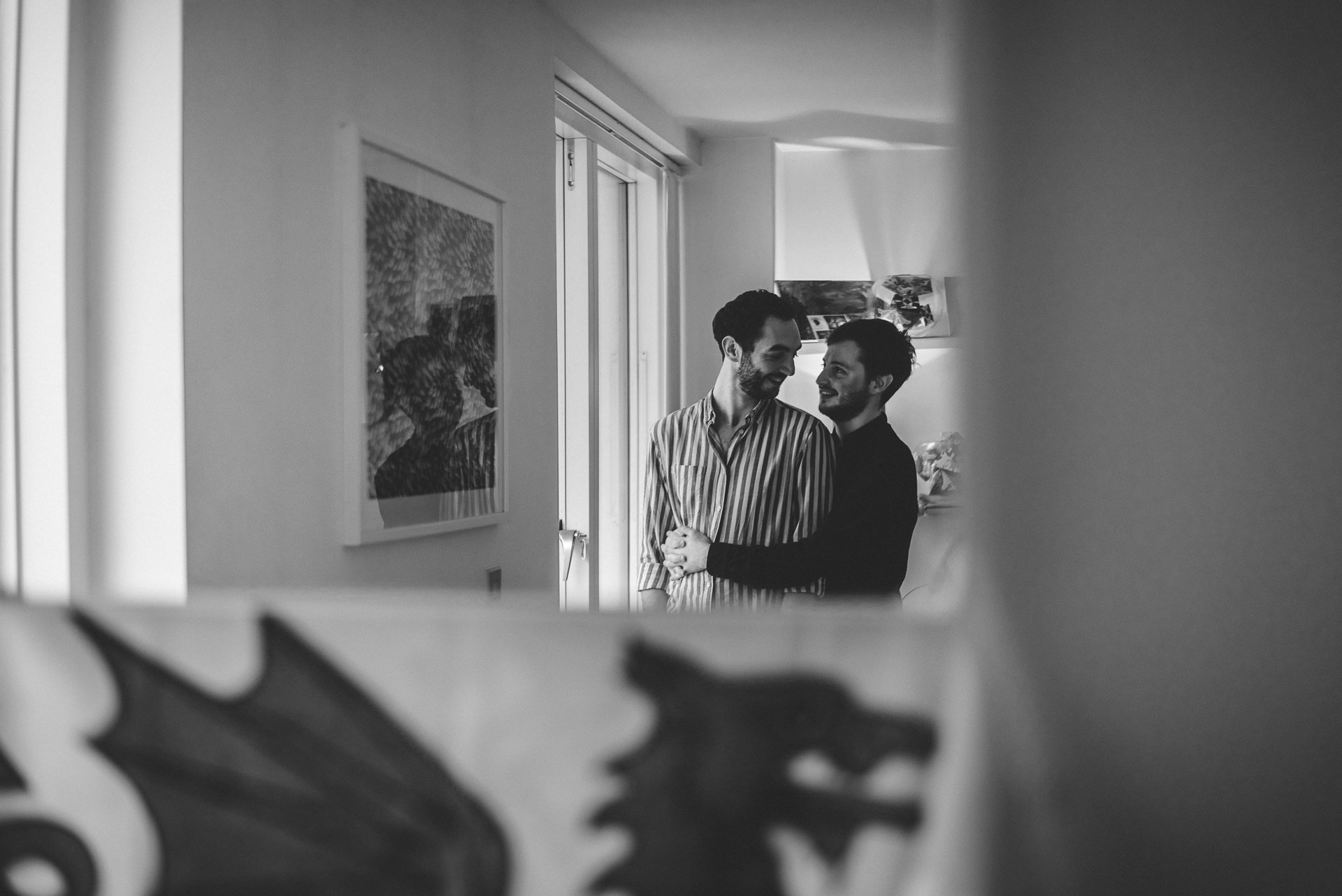 Reflection in a mirror of couple cuddling. Fun, romantic at-home London engagement shoot ideas
