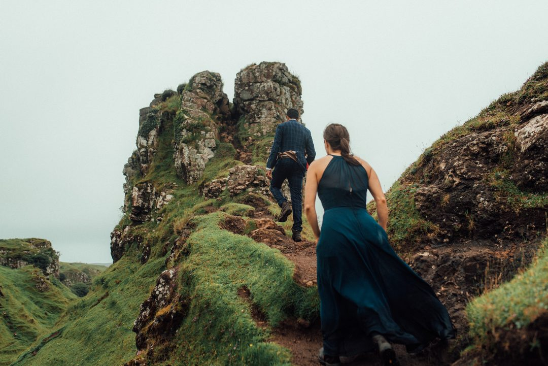 couple walk up to castle ewan at the fairy glen