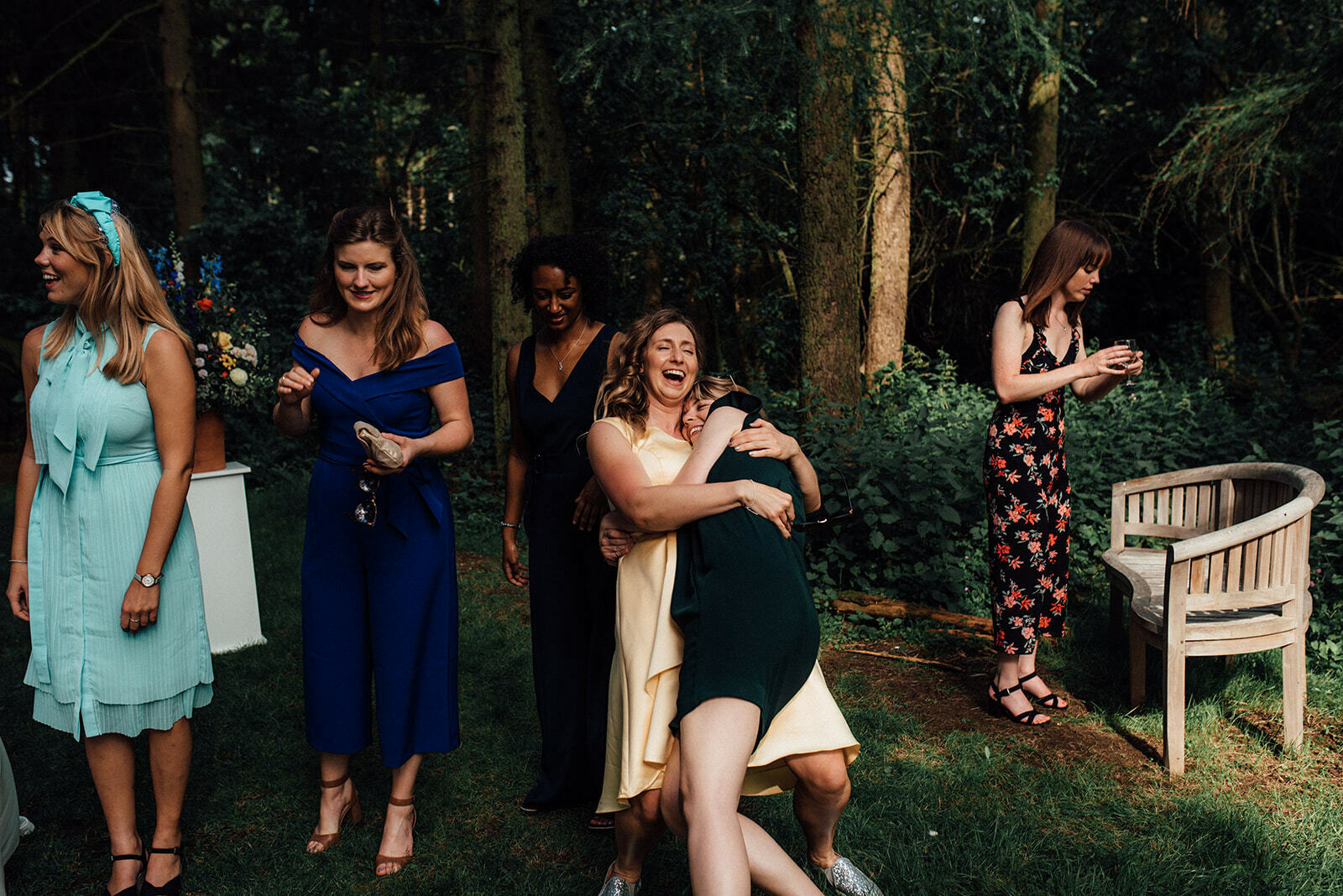 Guests hug and laugh during a Lineham Farm wedding