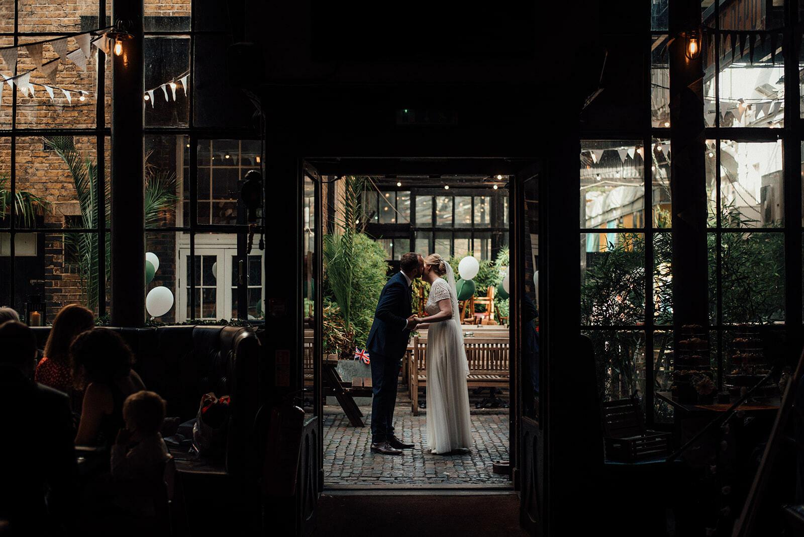 Bride and Groom kiss in the doorway of The Depot N7