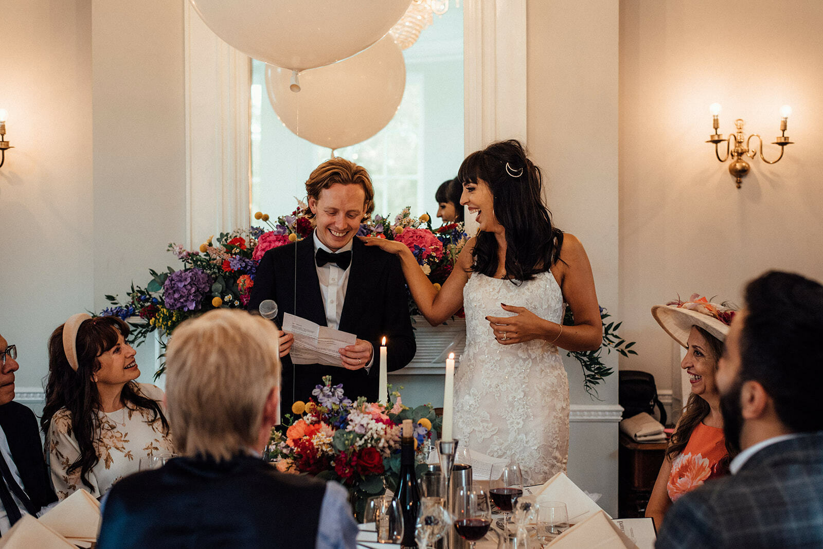 bride laughs at groom during their joint speech at Belair House