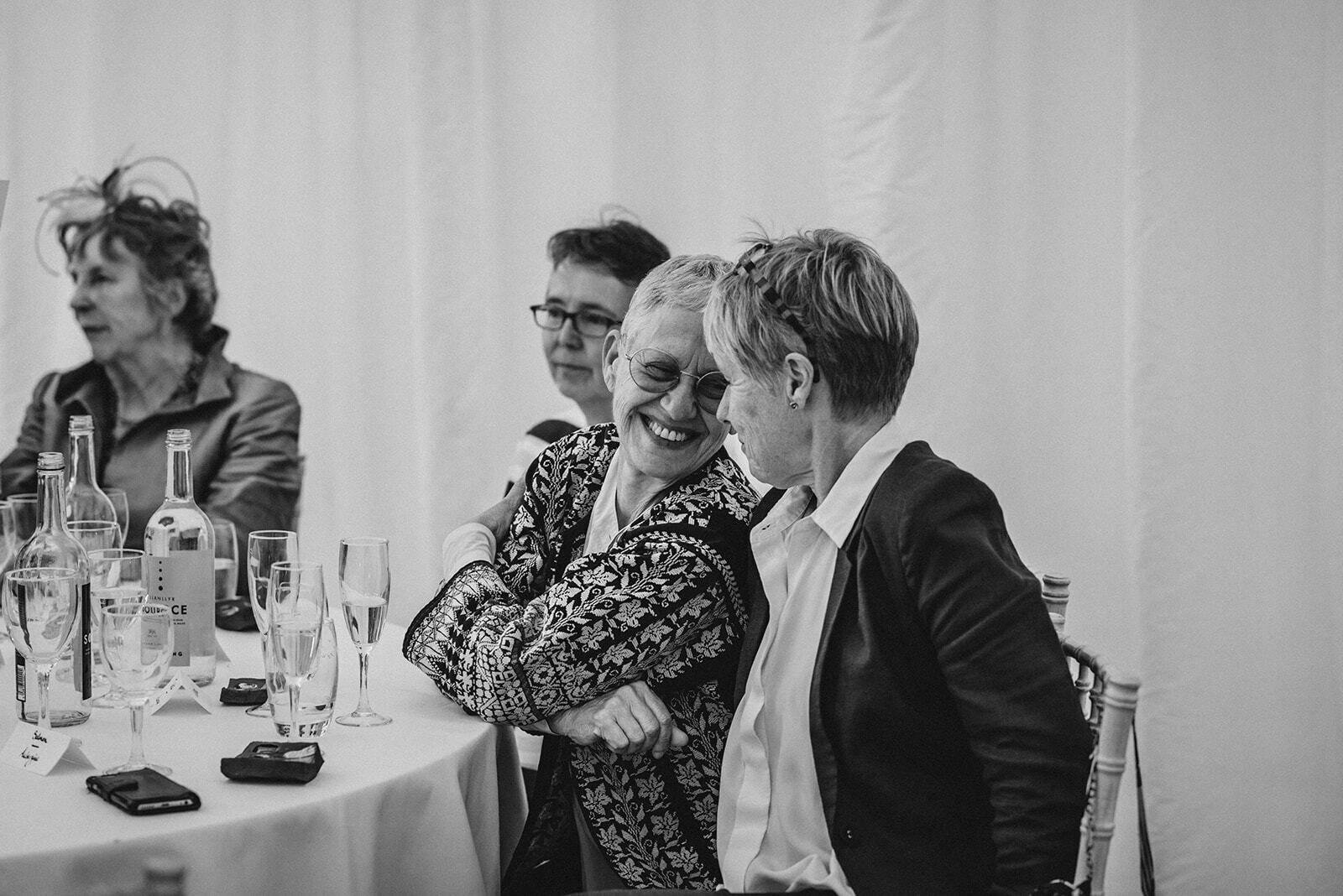 Guests look at each other affectionally during a wedding