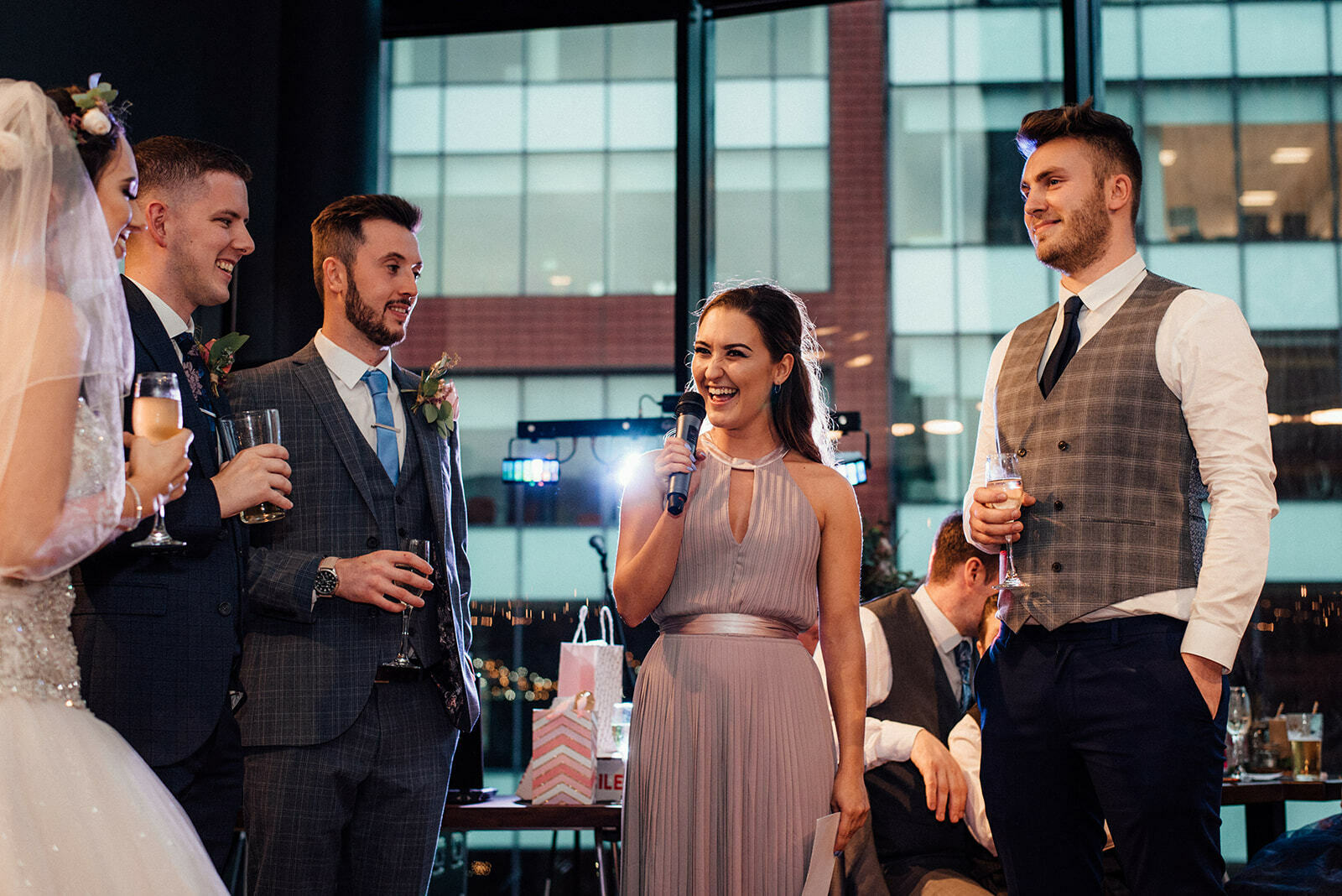 a bridesmaid laughs during her speech at a wedding in HOMEmcr