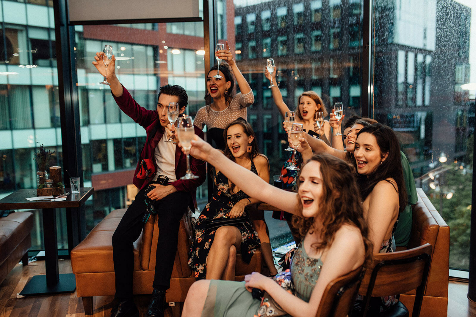 a group of guests raise their glasses during speeches at a wedding in HOMEmcr